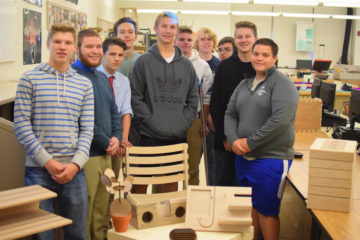 picture-South Park Engineering Design and Development students with their product prototypes