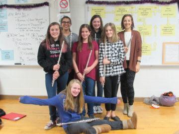 picture - PVIS Flautists (Back Row) Diana Palade, Adalie Clemmer, (Miss Morgann Davis - professional)                                     (Front Row) Michaela Sheets, Kiersten Winey, Olivia R. Ammon, Grace Runner