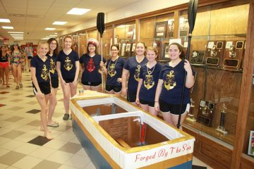 """The """"Nautical Elegance"""" team prepares for competition."""