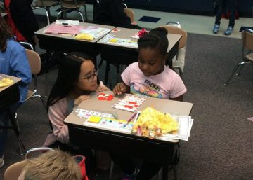 Middle schoolers help elementary students follow a visual recipe.